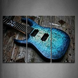 Guitar In Blue Looks Magical Lies On Wooden Wall Art Paintin